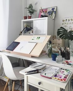 Lovely workspace for an art desk in the home office / art studio space. Desktop easel / drafting table surface plus cabinets and drawers to keep art supplies. Bureau D'art, Desk Inspo, Workspace Inspiration, Inspiration Boards, Bedroom Inspiration, Art Desk, New Room, Office Decor, Office Art