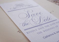 Picture of a blue save the date wedding card
