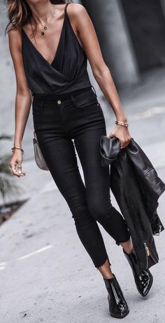 scrappy wrap bodysuit + black skinny jeans + black booties + black leather jacket Street style, street fashion, best street style, OOTD, OOTD Inspo, street style stalking, outfit ideas, what to wear now, Fashion Bloggers, Style, Seasonal Style, Outfit Inspiration, Trends, Looks, Outfits.