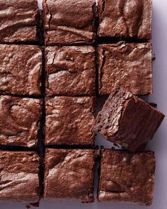 Chewy Brownies | Martha Stewart Living - Upgrade your Super Bowl spread with our holy-grail brownies that are perfectly gooey on the inside and deliciously crackly on top.