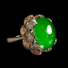 Imperial green jade and diamond ring.