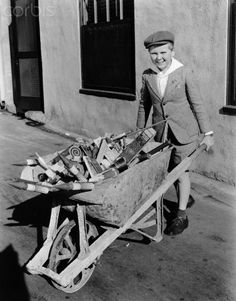 Actor Jackie Cooper Carrying Wagonload of Fireworks