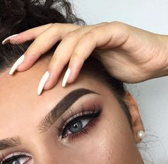 I'm really liking this makeup look just because you could really spin this off any way you wanted, make it more glam or more natural, or replicate it the same. I think the bold brows paired with the bronzey red eyeshadow is super classy, and adding the wing with these wispy lashes is even prettier. Loving this look. -Xoxo, Ari