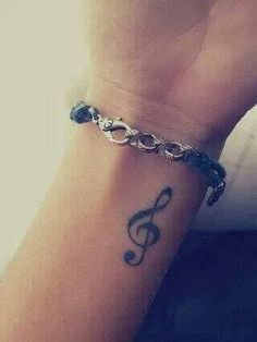 Treble clef, white ink, my last name backwards