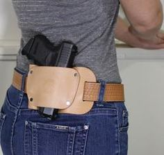 "Concealed carry holster for women  by Concealed Carry Wear - ""the Coyote"" model holster worn with a leather belt. Shop for both at www.wearccw.com"