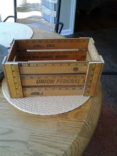 Small storage crate made from antique yardsticks!