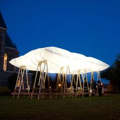 Inflatable roof for pavilion. A design using modular elements like this that could appear and disappear for events/seasons. Without the roof the struts are still structural and could support wind turbines and giant bench swings.