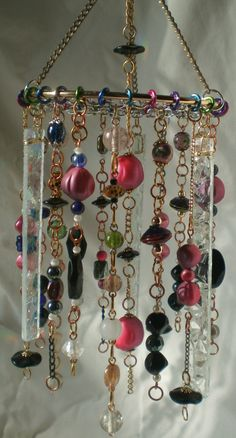 Bead beaded Windchime - not sure why but I like it...from http://www.etsy.com/listing/88599194/sounds-of-spring-wind-chime-recycled?utm_campaign=Share_medium=PageTools_source=Pinterest