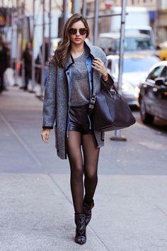 Miranda Kerr: City chic in leather shorts, Givenchy shorts and Isabel Marant boots.