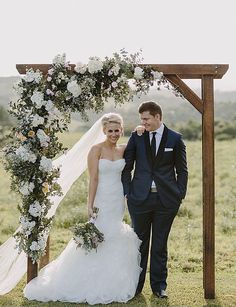 Asymmetrical Floral - Wedding Arbor Inspiration from FiftyFlowers