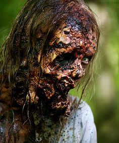 The Walking Dead a lot of speculation this is Andrea similar clothes, handcuffs, hair, head wound.