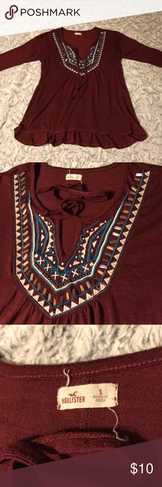 Burgundy top from Hollister Pretty burgundy top with beading and embroidery detail and ties. EUC Hollister Tops
