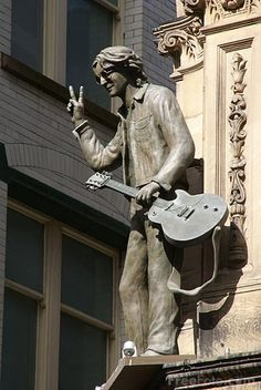 """Statue of Beatle John Lennon outside the """"Hard Day's Night"""" Hotel in Liverpool, ENGLAND."""