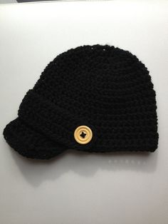 Boys newsboy cap with peak and button detail. Black cap with wooden button detail. Other colours available. on Etsy, $18.00 AUD