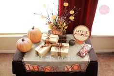 love the look of this whole table. The branches with pumpkins hanging, the little pumpkin sign, the thank you garland. :)