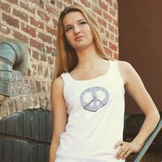 "Happy that Summer is trying out a prototype of our upcoming ""Smart Peace"" tank.  Thanks to David Cottle Photography for the cool pic!   #peaceofmind #geekchic #springstyle #springfashion #techie #artandtechnology #peacesign #peaceheart #peaceful #techlove"