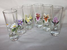 Handpainted flowers on shot glasses hand wash only 5.00 each.. The cost of shipping depends on the quanity that are purchased. Up to 2 Glasses