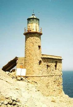 Constructed in 1864 by French engineers in the service of the Ottoman Empire, the abandoned Agios Ioannis Lighthouse is located at the seaward edge of a knife-edge ridge at the northern entrance to the Gulf of Mirambéllou in northeastern Crete. Though the lighthouse's stone structure is sound, the white paint that once covered the walls has long since peeled away. In addition, the loss of the tower's metal lantern dome in a 2008 storm has left the interior vulnerable to rain and airborne…