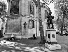 This statue of Samuel Johnson, also known as Doctor Johnson, is located at the rear of St Clemence Danes church which is located in the middle of Strand with traffic passing both sides. Johnson's most famous work was a dictionary. #London #mkhardy #Street #Photography #blackandwhite #monochrome