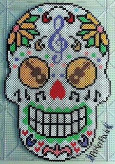 As requested by here's a sugar skull! (Sorry it took me so long!) I didn't come up with the designs for this, however I did make the perler as shown. Full credit goes to the original creator(s).