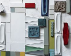 Building Bridges | American Craft Council -- A mix of current production field tiles and colors sit side-by-side with some of Heath's current production oval tiles. The turquoise tile (center) is an experimental design from 1960. Photo: Laurie Frankel
