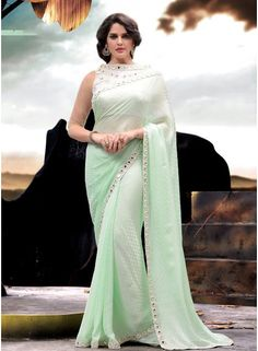 Delightful Turquoise Satin Jacquard With Border Work Fancy Saree - See more at: http://www.angelnx.com/Sarees/Designer-Sarees
