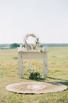 vintage rustic altar... rug on grass is cool!