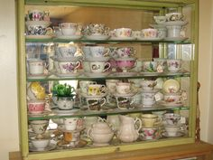 THIS IS A COLLECTION OF MY TEA CUPS AND SAUCERS IN MY DINING ROOM, ABOUT TO BECOME A CHANDELIER. ALPENA MI.