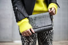 Neon sweater + patterned pants + tweed clutch