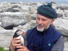 Dr. Steve Kress, VP, Bird Conservation Director, Seabird ...holding a puffin