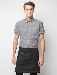 The Scout Short Waist Apron in Black Denim is a super stylish uniform essential perfect for the hospitality industry. This unique apron is made from 100% cotton denim and features accents of detail including our signature gold stud, and a large front pocket for storing work essentials. Also available in a full bib apron, allowing you to create a cohesive look for your crew while accommodating for different roles across your venue. Please refer to the CARE tab to get the best wear from your…