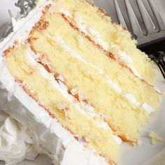 This vanilla cake recipe makes a luscious four layer  cake filled with a yummy vanilla sour cream frosting.
