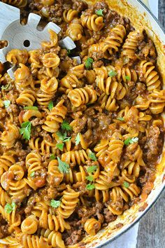 An easy and delicious recipe for One-Pot Cheesy Taco Pasta loaded with ground beef and lots of shredded cheese, ready in about 30 minutes!