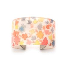 "Floral Watercolor Capped Cuff - 1.5""  Interlayer: Floral Watercolor  What's Inside: Hand-painted by an artist in our Home Office Salt Lake City, Utah, this beautiful watercolor design is preserved inside our ecoresin. The colorful floral masterpiece was inspired by one of her favorite places to visit--The mountain trails near her home where she often hikes that are covered with vibrantly colored wildflowers!  Cuff Width: 1.5""  Metals/Materials: Antique silver-plated brass caps, Ecoresin"