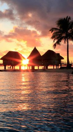 Watch the sun set from your overwater bungalow on this private island in #BoraBora. [Promotional Pin]