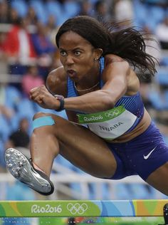 Barbara Nwaba of the United States competes in a heat of the women's heptathlon 100-meter hurdles during the Summer