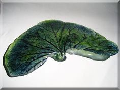 Big Casted leaf in Green/Blue Aventurine Bullseye art-glass.. it have been casted with 4 feet so it stand straight..  The leaf-veins is made of Bullseye Black opal Powder.  This plate is 28 X 19 cm.
