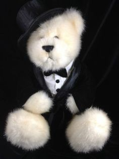 How adorable is this plush Gund teddy bear dressed as he is in formal attire that includes a tuxedo and top hat?!? #gund #teddybears #tuxedos