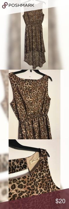 Liberty Love Cheetah Dress Super cute high low cheetah print dress in the size medium. 34 1/2 in. long (front) & 46 in. long in the back. Great condition. Liberty Love Dresses High Low