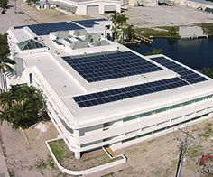 Integrated Solar TPO Roof | Lasher Construction LLC | www.lashercorp.com | 856-375-2372 | NJ Commercial Roofing Commercial Roofing, Outdoor Furniture Sets, Outdoor Decor, Exterior Design, Solar, Backyard, Construction, Fire, Building