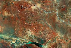 Sentinel-2A takes us over part of Botswana's Central District in this false-colour image captured on 22 March 2016.Rivers and roads cut through the landscape, while the bright, circular areas represent villages where the vegetation has been cleared away. Areas of thicker vegetation appear…