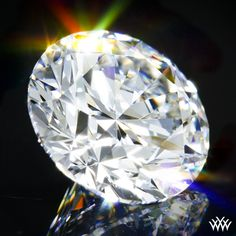 1.115 carat E color VS1 clarity A CUT ABOVE® Hearts and Arrows Super Ideal Round Cut Loose Diamond - Hearts and Arrows Ideal Proportions and a AGS Diamond Report. Price $15,791   www.whiteflash.com