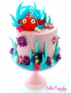 how adorable is this Nemo cake? by Vanessa @ Bella Cupcakes Pretty Cakes, Cute Cakes, Beautiful Cakes, Amazing Cakes, Finding Nemo Cake, Rodjendanske Torte, Strawberry Cream Cakes, Decoration Patisserie, Sea Cakes