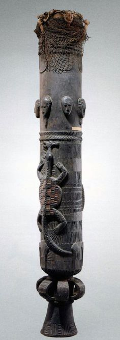 Africa | Drum from the Baule people of Ivory Coast | Leather, hide and vegetal fiber | 20th century. The harder you hit the louder the sound to be produced