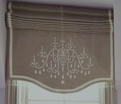 The roman shade with chandelier motif is   edged in Swarvoski crystals in a whimsical play on the subject.