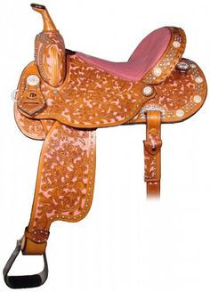 Double J Pro Barrel Racer Saddle with a pink dyed background & Bowan floral tooling. Awesome pink stingray seat & lots of crystals.