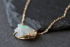 NEW from the winter LACUNA collection    simple, earthy, luxe. A natural, raw australian opal is set in handcrafted 14kt gold filled prongs