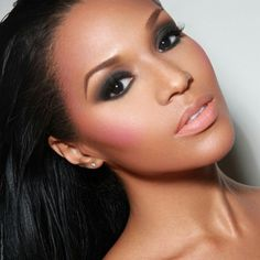 An intense smokey eye with soft nude pink lips & cheeks for the bride wanting a dramatic look but not overdone.