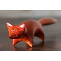 Fox sculpture by Perry Lancaster. A lovely orange Fox, carved from stunning Padauk wood.