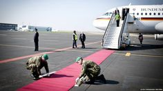 This week, German Chancellor Angela Merkel had to wait on the gangway of her plane after she landed in Prague, while soldiers adjusted the red carpet. Thoughts on perfection and the beauty of imperfection.